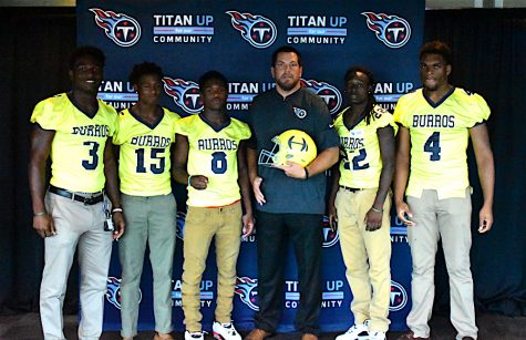 Josh Corey, center, poses with key Hillsboro High School football players who attend the 2nd Annual Tennessee Titans High  School Media Day. Corey is the Outreach Coordinator for the Tennessee Titans
