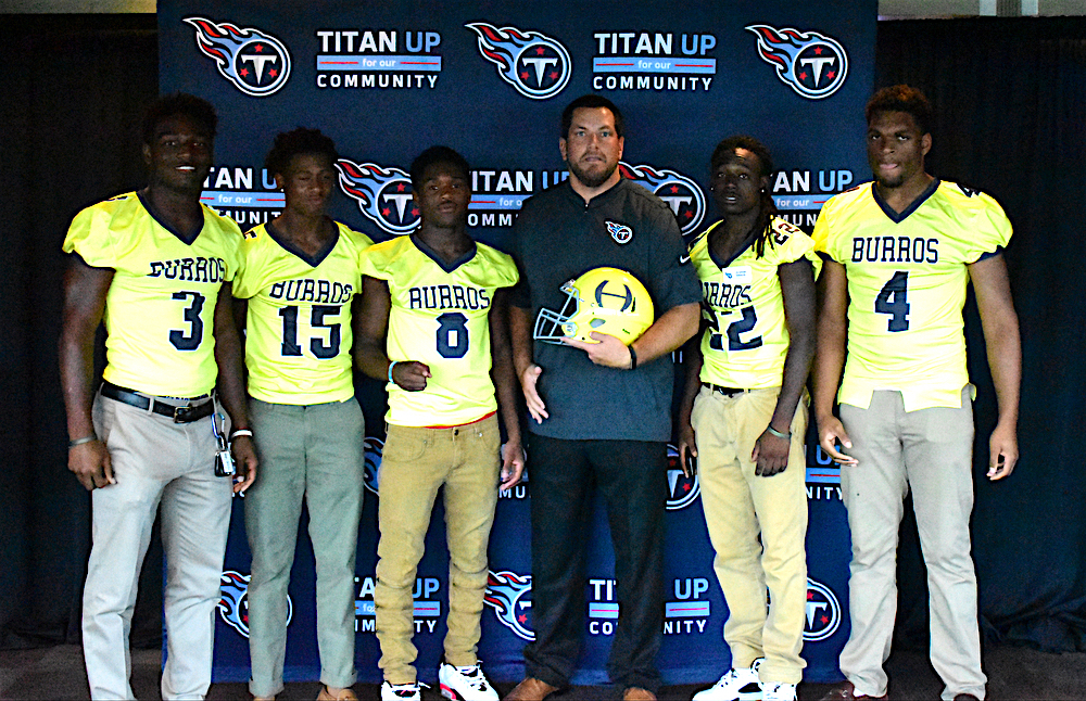 Josh+Corey%2C+center%2C+poses+with+key+Hillsboro+High+School+football+players+who+attend+the+2nd+Annual+Tennessee+Titans+High++School+Media+Day.+Corey+is+the+Outreach+Coordinator+for+the+Tennessee+Titans