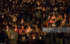 CHARLOTTESVILLE, VA - AUGUST 16: Hundreds of people march peacefully with lit candles across the University of Virginia campus on Wednesday, August 116, 2017, in Charlottesville, VA, in the wake of violence in the city and against torch-lit white nationalist parade the same campus last Friday night. Students and residents gathered at the universitys Rotunda in Charlottesville to sing together for an evening vigil that stood in stark contrast to last weeks torch-lit march of white supremacists. (Photo by Salwan Georges/The Washington Post via Getty Images