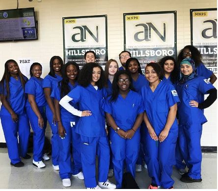 In medical scrubs, MNPS St. Thomas Scholars spent the day in service and learning.