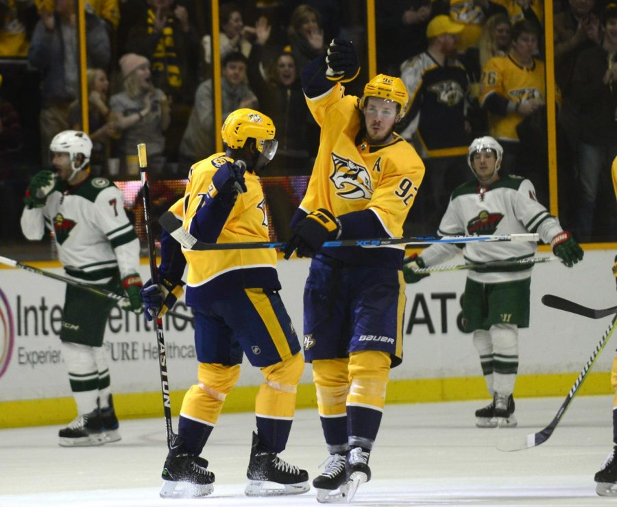 Nashville Predators defenseman P.K. Subban (76) and center Ryan Johansen (92) celebrate a goal by Subban in the third period of an NHL hockey game against the Minnesota Wild, Saturday, Dec. 30, 2017, in Nashville, Tenn. (AP Photo/Mike Strasinger)