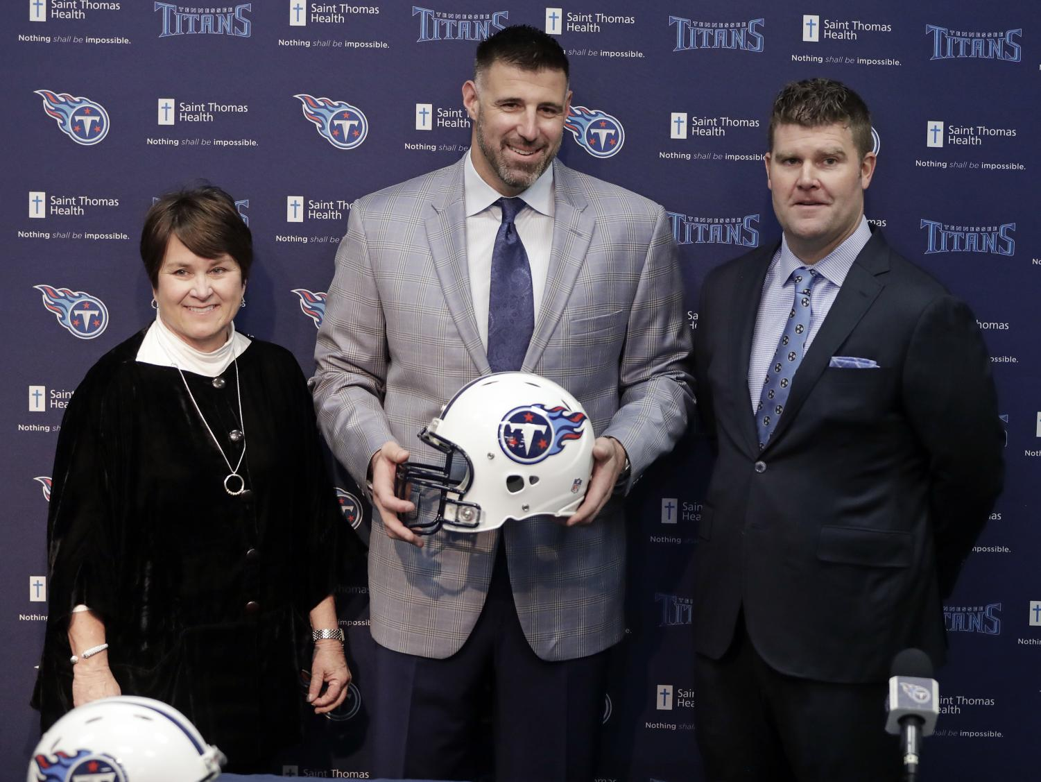 New Tennessee Titans NFL football head coach Mike Vrabel, center, poses with owner Amy Adams Strunk, left, and general manager Jon Robinson, right, during a news conference Monday, Jan. 22, 2018, in Nashville, Tenn. The Titans hired Vrabel, formerly the Houston Texans' defensive coordinator, five days after firing Mike Mularkey. (AP Photo/Mark Humphrey)