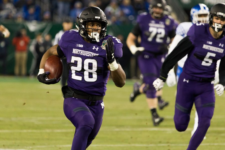 Northwestern+RB+Jeremy+Larkin+runs+for+a+64+yard+gain.+This+drive+ended+with+a+turnover+on+downs+on+Kentucky%27s+2+yard+line.%0A+%28Photo+Andrew+Brown+for+HillsboroGlobe.com%29