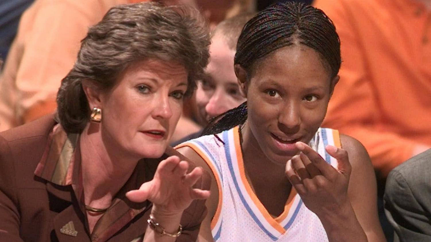 Tennessee head coach Pat Summitt talks with Chamique Holdsclaw on the bench as Holdsclaw ices her knees in the final minutes of their game against Florida at the SEC women's tournament in Chattanooga, Tenn. on Friday, Feb. 26, 1999. Tennessee defeated Florida, 92-80, to advance to the semifinal round of the tournament. (AP Photo/Mark Humphrey)