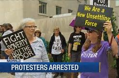 20 people protesting poverty were arrested in march from Legislative Plaza to the Justice A.A. Birch Building