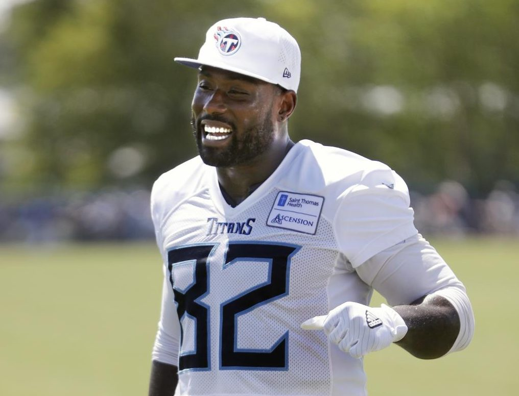 Tennessee Titans tight end Delanie Walker leaves the field after a practice at NFL football training camp Friday, July 27, 2018, in Nashville, Tenn. The Titans have agreed to terms on a two-year contract extension with Walker, keeping the veteran tight end under contract through 2020.