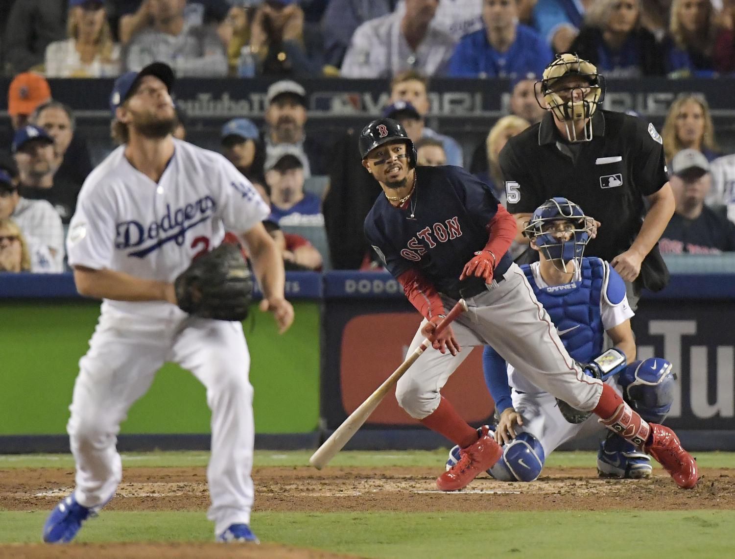 Boston Red Sox's Mookie Betts, right, watches his home run off Los Angeles Dodgers starting pitcher Clayton Kershaw during the sixth inning in Game 5 of the World Series baseball game on Sunday, Oct. 28, 2018, in Los Angeles. (AP Photo/Mark J. Terrill)