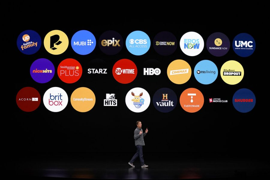 Peter Stern, Apple Vice President of Services, speaks at the Steve Jobs Theater during an event to announce new products Monday, March 25, 2019, in Cupertino, Calif. (AP Photo/Tony Avelar)