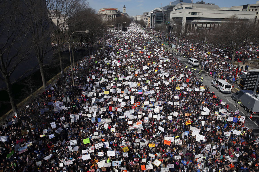 Looking west, people fill Pennsylvania Avenue during the