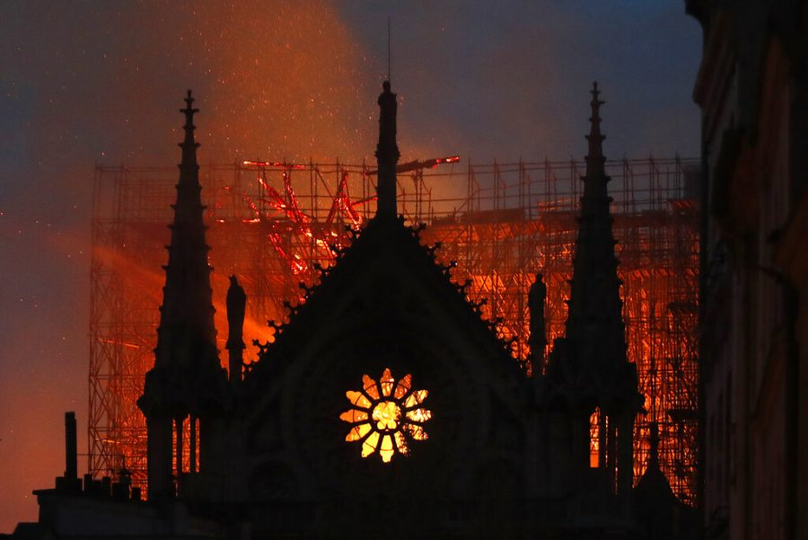 Flames+and+smoke+rise+from+Notre+Dame+cathedral+as+it+burns+in+Paris%2C+Monday%2C+April+15%2C+2019.+Massive+plumes+of+yellow+brown+smoke+is+filling+the+air+above+Notre+Dame+Cathedral+and+ash+is+falling+on+tourists+and+others+around+the+island+that+marks+the+center+of+Paris.+%28AP+Photo%2FThibault+Camus%29