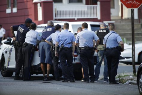 Philadelphia police stage as they respond to an active shooting situation, Wednesday, Aug. 14, 2019, in the Nicetown neighborhood of Philadelphia. (AP Photo/Matt Rourke) PHOTO 1