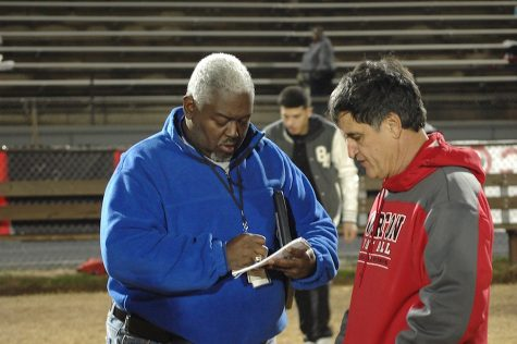 Maurice Patton, TSSAA Distinguished Contributor, 2019 interviewing 30 year veteran coach Terry Anderson on the last night of his coaching career following an undefeated season and a deep run into the playoffs, November 22, 2013 (photo America Leon)