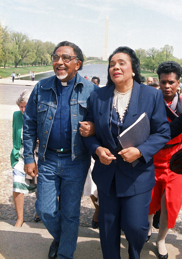 FILE+-+In+this+April+21%2C+1988%2C+file+photo%2C+Coretta+Scott+King%2C+widow+of+the+Rev.+Dr.+Martin+Luther+King+Jr.%2C+and+the+Rev.+Joseph+E.+Lowery%2C+president+of+the+Southern+Christian+Leadership+Conference%2C+walk+arm+in+arm+after+announcing+plans+for+a+rally+during+a+news+conference+at+the+Lincoln+Memorial+in+Washington.+Lowery%2C+a+veteran+civil+rights+leader+who+helped+King+Jr.+found+the+SCLC+and+fought+against+racial+discrimination%2C+died+Friday%2C+March+27%2C+2020%2C+a+family+statement+said.+He+was+98.+%28AP+Photo%2FBob+Daugherty%2C+File%29