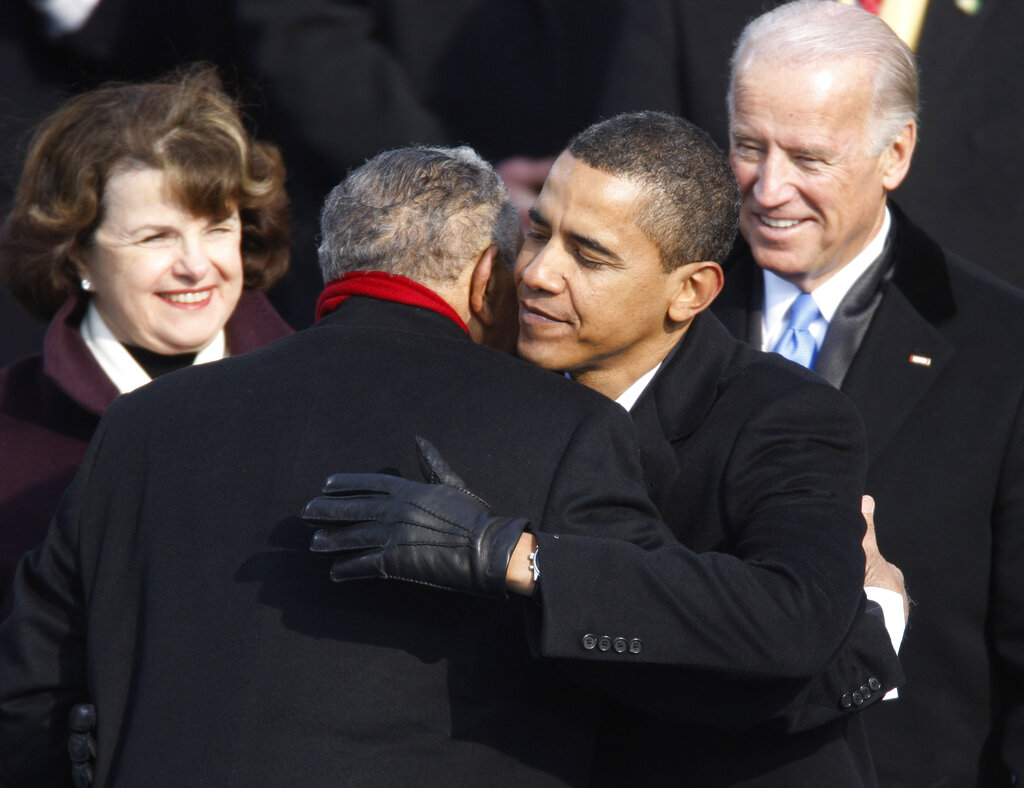 FILE+-+In+this+Jan.+20%2C+2009%2C+file+photo+President+Barack+Obama+embraces+civil+rights+icon+the+Rev.+Joseph+E.+Lowery+during+Obama%27s+inauguration+in+Washington%2C+as+Sen.+Dianne+Feinstein%2C+left%2C+D-Calif.%2C+and+Vice+President+Joe+Biden+watch.+Lowery%2C+a+veteran+civil+rights+leader+who+helped+the+Rev.+Dr.+Martin+Luther+King+Jr.+found+the+Southern+Christian+Leadership+Conference+and+fought+against+racial+discrimination%2C+died+Friday%2C+March+27%2C+2020%2C+a+family+statement+said.+He+was+98.+%28Jim+Bourg%2FPool+Photo+via+AP%2C+File%29
